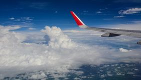 Wing of civil aircraft. Airplane wing view. An aircraft flying in the blue sky Stock Image