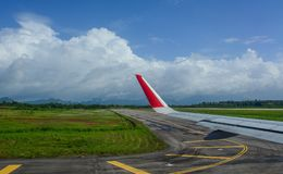 Wing of civil aircraft. On runway of Chiang Mai Airport, Thailand Stock Image
