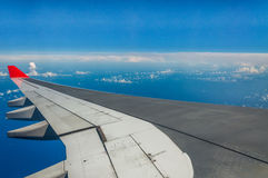Wing color. Airplane wing during a flight to dominican republic with nice blue sky Royalty Free Stock Photography