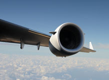 Wing and engine in flight Royalty Free Stock Photos