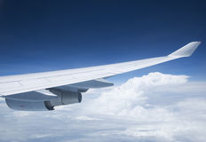 Wing and engine of passenger jet. Royalty Free Stock Image