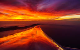 Wing on fire!. Sunset reflection on an airplane wing royalty free stock photo