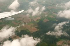 Aircraft wing from airplane in flight royalty free stock photo