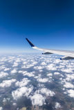 Wing of a Flying Airplane above clouds over Chennai. India Stock Image