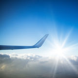 Wing of an flying airplane Royalty Free Stock Photos