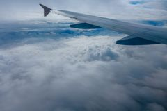 Wing of flying airplane in a fog. Wing of flying airplane in the clouds Royalty Free Stock Images