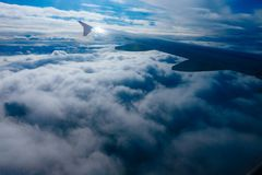 Wing of flying airplane in a fog. Wing of flying airplane in the clouds Royalty Free Stock Image