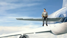On wing of flying airplane . Mixed media Stock Image
