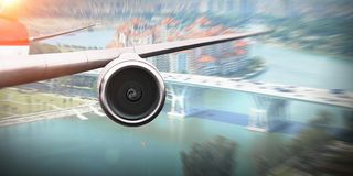 Close of airplane in sky. Mixed media Royalty Free Stock Photo