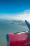 The wing and jet engine are visible ,phuket Stock Photo