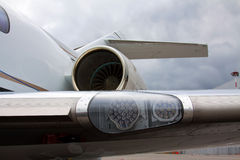Wing with lights and engine Stock Photos