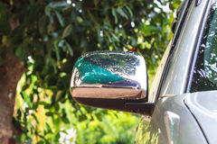 Wing mirror on a silver car Royalty Free Stock Photos