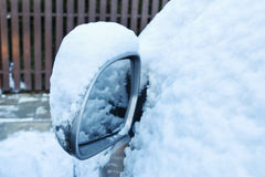 Wing mirror under the snow. Winter landscape Royalty Free Stock Photo