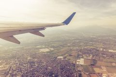 Free Wing Of An Airplane Flying Above Towns And Villages Royalty Free Stock Photos - 114999778
