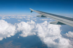 Wing over the clouds. Wing of airplane over the clouds Stock Image