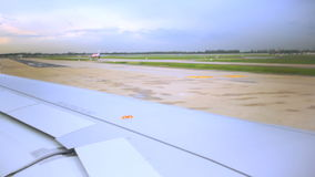 Wing of passenger airplane moving on runway or taxi prepare for take off at airport stock footage