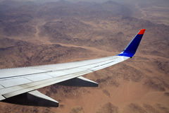 Wing of the plane. Stock Photo