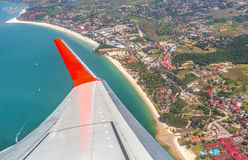 Wing of the plane above Langkawi Island. Royalty Free Stock Photos