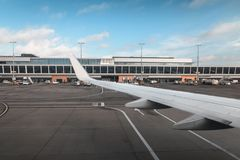 The wing of the plane at the airport at the landing.  royalty free stock photography