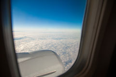 Wing of the plane on blue sky Royalty Free Stock Photo