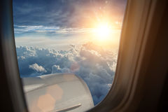 Wing of the plane on blue sky Royalty Free Stock Photos
