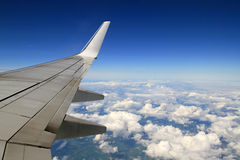Wing of the plane at flight Royalty Free Stock Photo