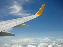Wing of the plane on sky Stock Images