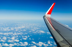 Wing of the plane on sky backgroun Stock Image