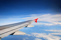 Wing of the plane on sky Royalty Free Stock Photo