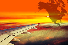 Wing of the plane at sunset Royalty Free Stock Photo