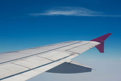 Wing of plane view from window. Of the airplane stock image