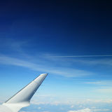 Wing of a private jet plane. This photograph represent a beautiful wing of a private jet airplane on a background of sky. Great picture to represent your Stock Photos