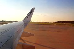 Wing of a Ryanair airplane on an airfield Royalty Free Stock Photo