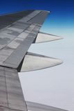 Wing. Siver airplane wing in blue sky Royalty Free Stock Images