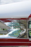 Wing of on small airoplane. With windows Stock Photography