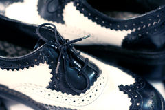 Wing tip shoes. Close up of black and white shoes royalty free stock photography