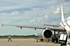 Wing view of airplane stopped Royalty Free Stock Photo