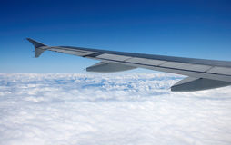 Wing View. View of wing, blue skies and clouds from window seat Stock Image