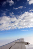 Wing view from a Jet cruising stock photo