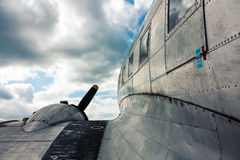 Wing view of metal vintage aircraft. And gloomy sky Royalty Free Stock Photography