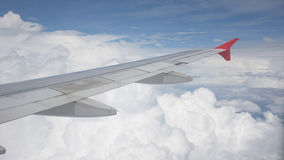 Wing view over blue sky Royalty Free Stock Photos