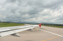 Wing view and taxi way before takeoff On cloudy days. Happy time Royalty Free Stock Images