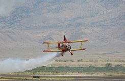 Wing Walker at the Airshow. Wing Walker performing her act at an Airshow Royalty Free Stock Photos