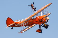 Wing Walker Lady. Breitling Wing-Walkers aeronautics team at an airshow show off their skills Royalty Free Stock Image