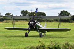 Wing walker plane. A close up picture of a small wing walker plane on a grassy field Royalty Free Stock Images