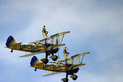 Wing walking. At RAF Fairford air tattoo air show UK bi plane biplane extreme exhilarating heights scared mad crazy brave overcome fear brave Stock Photos