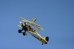 Wing walking. At RAF Fairford air tattoo air show UK bi plane biplane extreme exhilarating heights scared mad crazy brave overcome fear brave Royalty Free Stock Photography