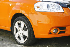 Wing, wheel and car headlight bright color, close-up Stock Image