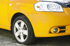 Wing, wheel and car headlight bright color, close-up Stock Images