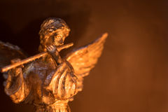 Winged Angel Playing Flute stock image
